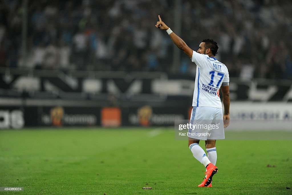 Dimitri Payet of Marseille celebrates scoring his team's first goal during the French Ligue 1 match between Olympique de Marseille and OGC Nice at...