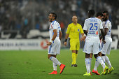 Dimitri Payet of Marseille celebrates scoring his team's first goal with his teammates during the French Ligue 1 match between Olympique de Marseille...