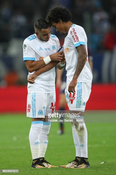 Dimitri Payet of Marseille gives over the captains armband to Luiz Gustavo of Marseille during the Ligue 1 match between Olympique Marseille and...