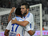 Dimitri Payet of Marseille is congratulated by his teammate AndrePierre Gignac for the team's third goal during the French Ligue 1 match between...
