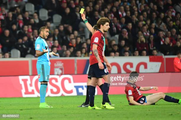 Dimitri Payet of Marseille receives a yellow card during the Ligue 1 match between Lille OSC and Olympique de Marseille at Stade Pierre Mauroy on...
