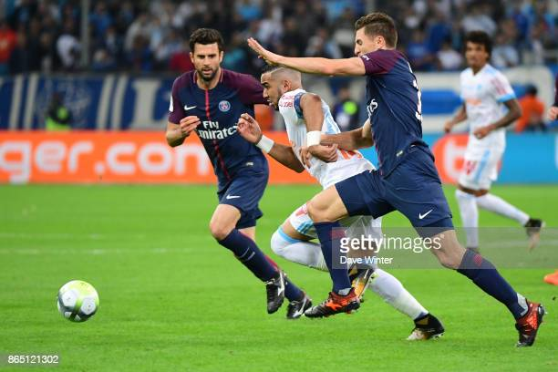 Dimitri Payet of Marseille takes on the opposition defence during the Ligue 1 match between Olympique Marseille and Paris Saint Germain at Stade...