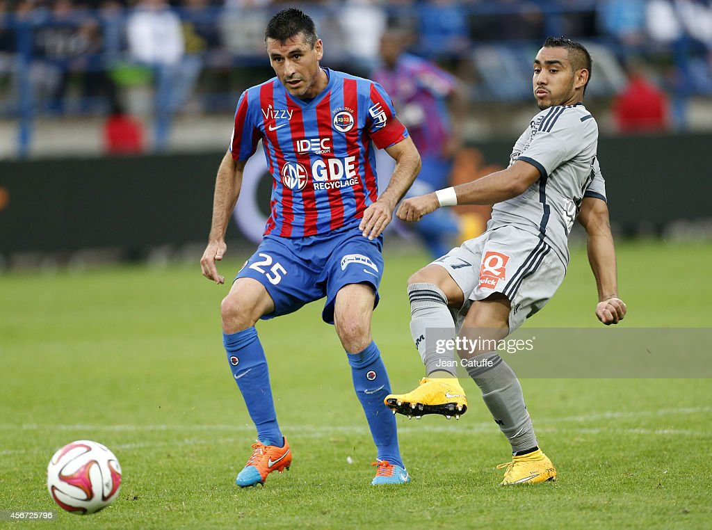 Dimitri Payet of OM and Julien Feret of Caen in action during the French Ligue 1 match between Stade Malherbe de Caen and Olympique de Marseille at...