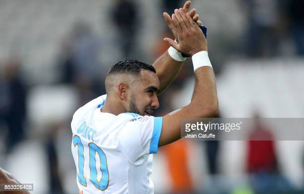 Dimitri Payet of OM celebrates the victory following the French Ligue 1 match between Olympique de Marseille and Toulouse FC at Stade Velodrome on...