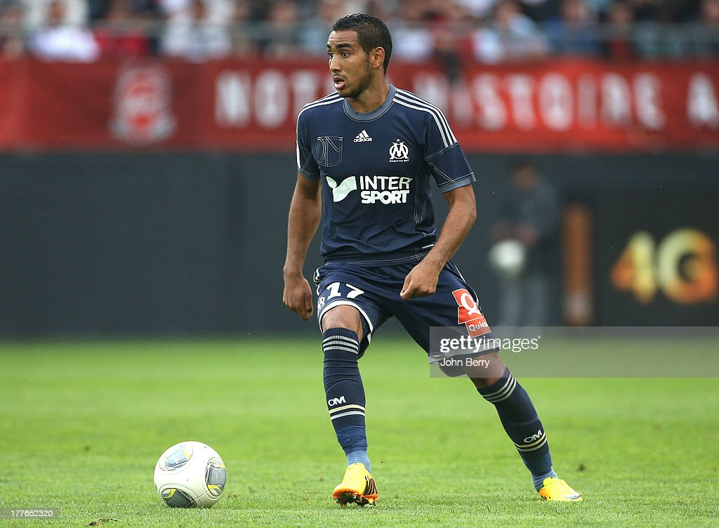 <a gi-track='captionPersonalityLinkClicked' href=/galleries/search?phrase=Dimitri+Payet&family=editorial&specificpeople=2137146 ng-click='$event.stopPropagation()'>Dimitri Payet</a> of OM in action during the French Ligue 1 match between Valenciennes FC and Olympique de Marseille OM at the Stade du Hainaut stadium on August 24, 2013 in Valenciennes, France.