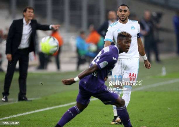 Dimitri Payet of OM in action while coach of OM Rudi Garcia gestures during the French Ligue 1 match between Olympique de Marseille and Toulouse FC...