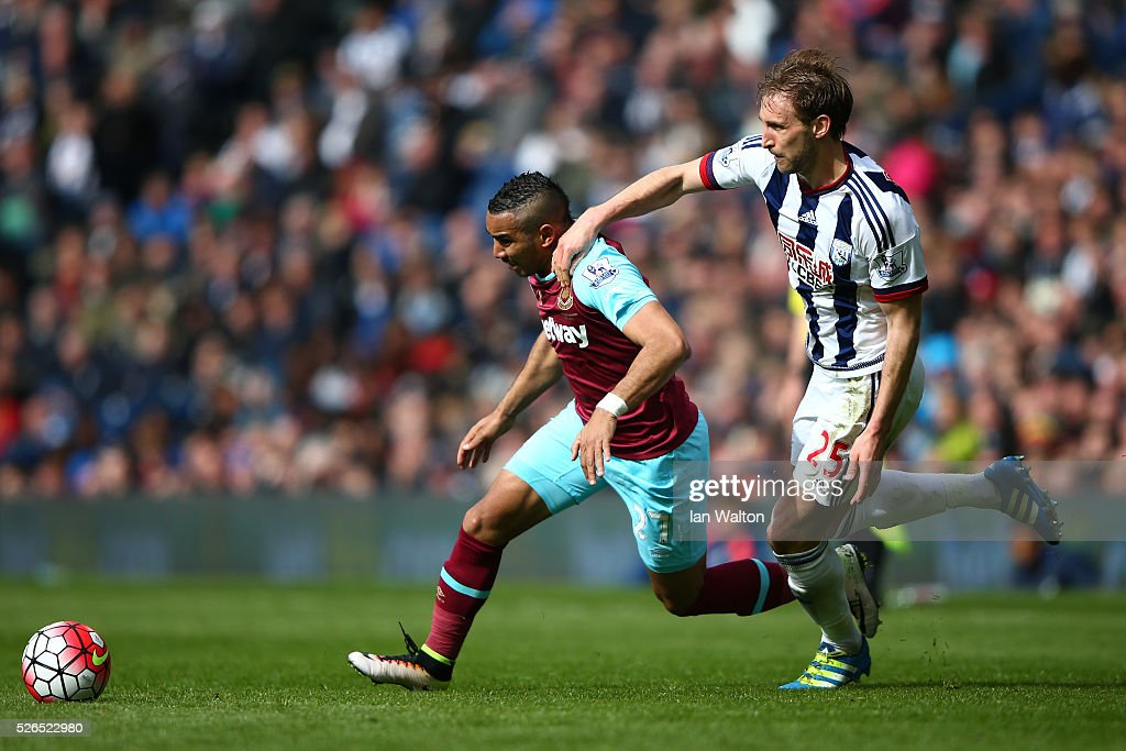 Dimitri Payet of West Ham United and Craig Dawson of West Bromwich Albion compete for the ball during the Barclays Premier League match between West Bromwich Albion and West Ham United at The Hawthorns on April 30, 2016 in West Bromwich, England.