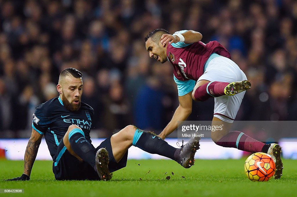 Dimitri Payet of West Ham United and Nicolas Otamendi of Manchester City compete for the ball during the Barclays Premier League match between West Ham United and Manchester City at the Boleyn Ground on January 23, 2016 in London, England.
