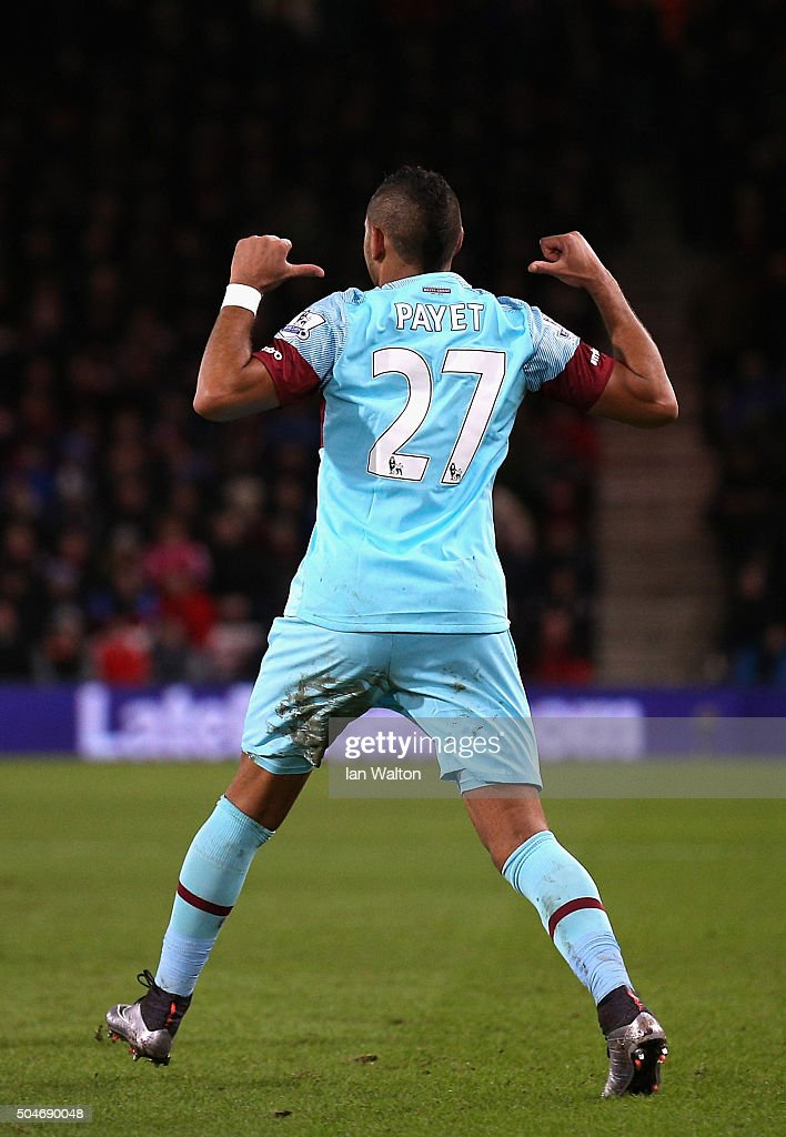 <a gi-track='captionPersonalityLinkClicked' href=/galleries/search?phrase=Dimitri+Payet&family=editorial&specificpeople=2137146 ng-click='$event.stopPropagation()'>Dimitri Payet</a> of West Ham United celebrates as he scores their first and equalising goal from a free kick during the Barclays Premier League match between A.F.C. Bournemouth and West Ham United at Vitality Stadium on January 12, 2016 in Bournemouth, England.