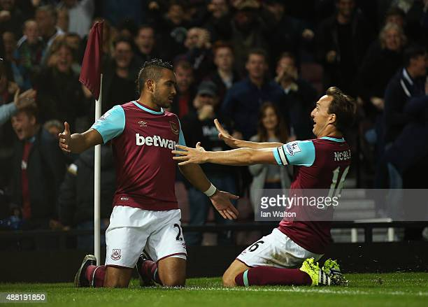 Dimitri Payet of West Ham United celebrates scoring the opening goal with Mark Noble of West Ham United during the Barclays Premier League match...