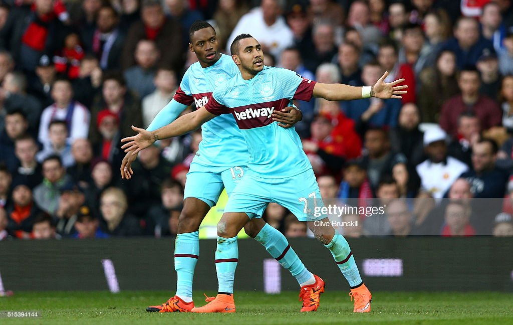 <a gi-track='captionPersonalityLinkClicked' href=/galleries/search?phrase=Dimitri+Payet&family=editorial&specificpeople=2137146 ng-click='$event.stopPropagation()'>Dimitri Payet</a> of West Ham United (27)celebrates with <a gi-track='captionPersonalityLinkClicked' href=/galleries/search?phrase=Diafra+Sakho&family=editorial&specificpeople=6690415 ng-click='$event.stopPropagation()'>Diafra Sakho</a> as he scores their first goal from a free kick during the Emirates FA Cup sixth round match between Manchester United and West Ham United at Old Trafford on March 13, 2016 in Manchester, England.