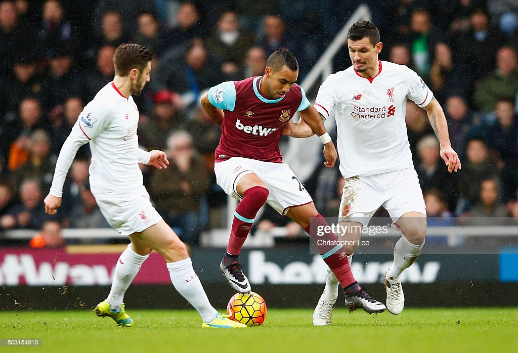 <a gi-track='captionPersonalityLinkClicked' href=/galleries/search?phrase=Dimitri+Payet&family=editorial&specificpeople=2137146 ng-click='$event.stopPropagation()'>Dimitri Payet</a> (C) of West Ham United competes for the ball against <a gi-track='captionPersonalityLinkClicked' href=/galleries/search?phrase=Adam+Lallana&family=editorial&specificpeople=5475862 ng-click='$event.stopPropagation()'>Adam Lallana</a> (L) and <a gi-track='captionPersonalityLinkClicked' href=/galleries/search?phrase=Dejan+Lovren&family=editorial&specificpeople=5577379 ng-click='$event.stopPropagation()'>Dejan Lovren</a> (R) of Liverpool during the Barclays Premier League match between West Ham United and Liverpool at Boleyn Ground on January 2, 2016 in London, England.
