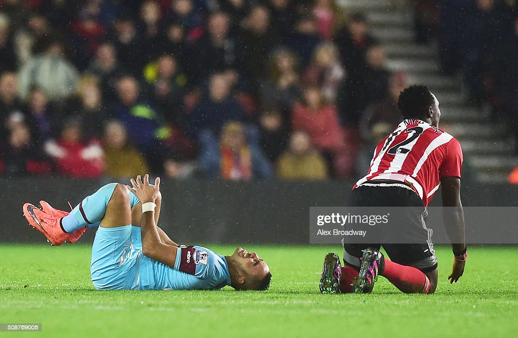 <a gi-track='captionPersonalityLinkClicked' href=/galleries/search?phrase=Dimitri+Payet&family=editorial&specificpeople=2137146 ng-click='$event.stopPropagation()'>Dimitri Payet</a> of West Ham United reacts after a challenge by <a gi-track='captionPersonalityLinkClicked' href=/galleries/search?phrase=Victor+Wanyama&family=editorial&specificpeople=7126412 ng-click='$event.stopPropagation()'>Victor Wanyama</a> of Southampton during the Barclays Premier League match between Southampton and West Ham United at St Mary's Stadium on February 6, 2016 in Southampton, England.