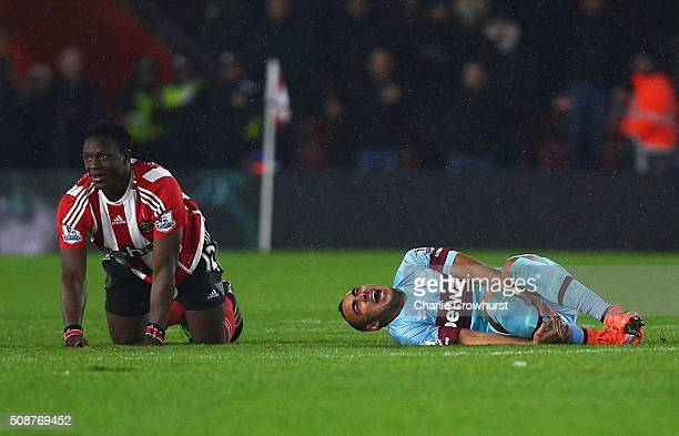 Dimitri Payet of West Ham United reacts after a challenge by Victor Wanyama of Southampton during the Barclays Premier League match between...