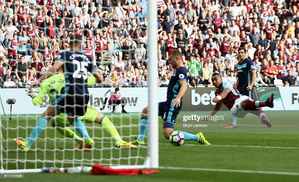 Dimitri Payet of West Ham United scores his sides first goal during the Premier League match between West Ham United and Middlesbrough at London Stadium on October 1, 2016 in London, England.