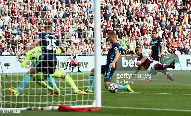Dimitri Payet of West Ham United scores his sides first goal during the Premier League match between West Ham United and Middlesbrough at London...