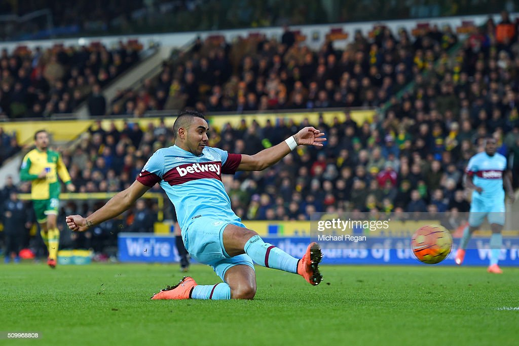 Dimitri Payet of West Ham United scores his team's first goal during the Barclays Premier League match between Norwich City and West Ham United at...