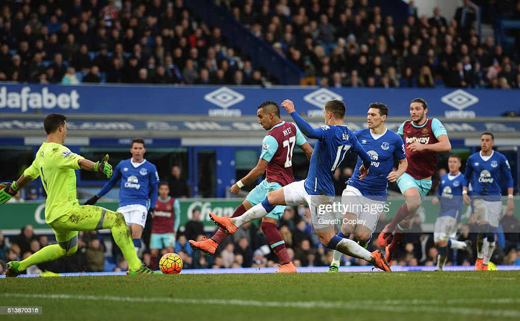 Dimitri Payet of West Ham United scores his team's third goal during the Barclays Premier League match between Everton and West Ham United at...