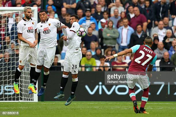 Dimitri Payet of West Ham United takes a freekick during the Premier League match between West Ham United and Watford at Olympic Stadium on September...
