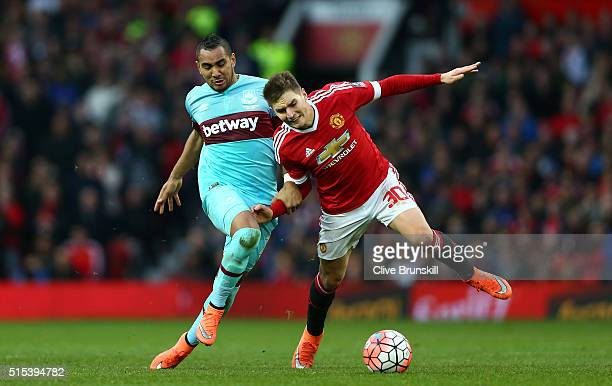 Dimitri Payet of West Ham United tussles with Guillermo Varela of Manchester United during the Emirates FA Cup sixth round match between Manchester...