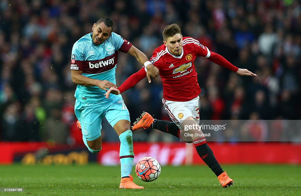 <a gi-track='captionPersonalityLinkClicked' href=/galleries/search?phrase=Dimitri+Payet&family=editorial&specificpeople=2137146 ng-click='$event.stopPropagation()'>Dimitri Payet</a> of West Ham United tussles with <a gi-track='captionPersonalityLinkClicked' href=/galleries/search?phrase=Guillermo+Varela&family=editorial&specificpeople=10113482 ng-click='$event.stopPropagation()'>Guillermo Varela</a> of Manchester United during the Emirates FA Cup sixth round match between Manchester United and West Ham United at Old Trafford on March 13, 2016 in Manchester, England.