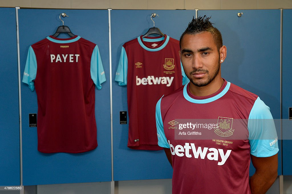 <a gi-track='captionPersonalityLinkClicked' href=/galleries/search?phrase=Dimitri+Payet&family=editorial&specificpeople=2137146 ng-click='$event.stopPropagation()'>Dimitri Payet</a> poses after signing for West Ham United at Upton Park on June 26, 2015 in London, England.