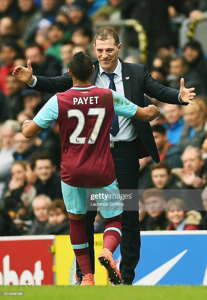 Dimitri Payetof West Ham United celebrates with Slaven Bilic manager of West Ham United after scoring his team's second goal from a free kick during...