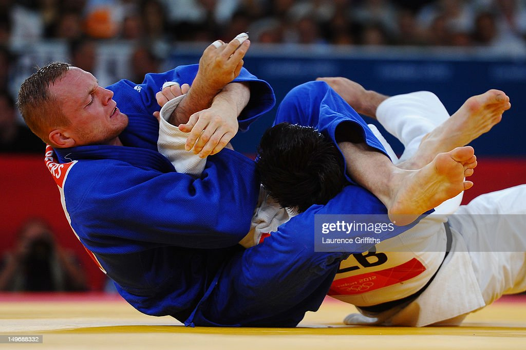 <a gi-track='captionPersonalityLinkClicked' href=/galleries/search?phrase=Dimitri+Peters&family=editorial&specificpeople=875495 ng-click='$event.stopPropagation()'>Dimitri Peters</a> of Germany (blue) competes with Ramziddin Sayidov of Uzbekistan in the Men's -100 kg Judo on Day 6 of the London 2012 Olympic Games at ExCeL on August 2, 2012 in London, England.