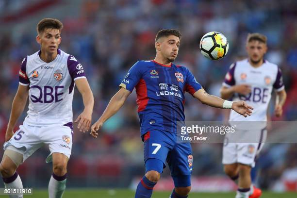 Dimitri Petratos of the Jets controls the ball during the round two ALeague match between the Newcastle Jets and the Perth Glory at McDonald Jones...