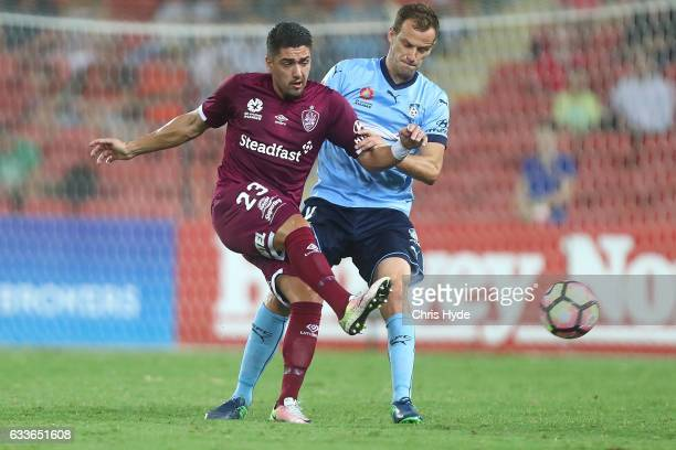 Dimitri Petratos of the Roar and Alexander Wilkinson of Sydney FC compete for the ball during the round 18 ALeague match between the Brisbane Roar...