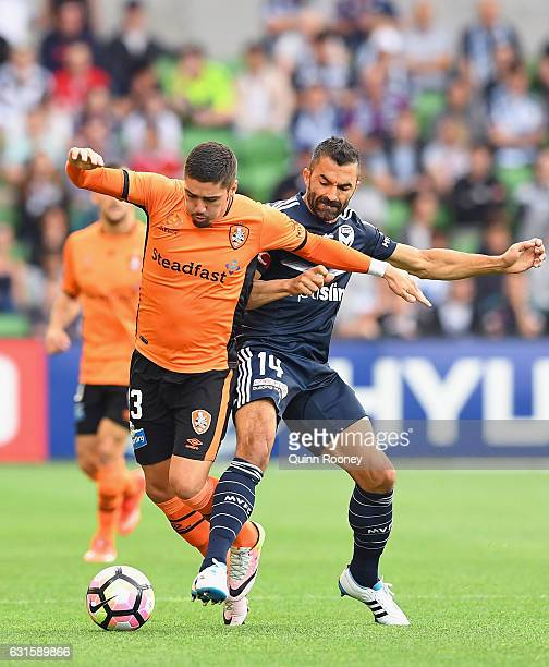 Dimitri Petratos of the Roar and Fahid Ben Khalfallah of the Victory compete for the ball during the round 15 ALeague match between the Melbourne...