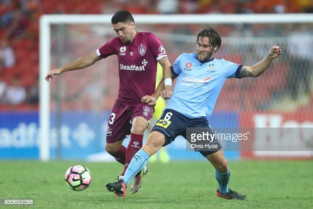 Dimitri Petratos of the Roar and Joshua Brillante of Sydney FC compete for the ball during the round 18 ALeague match between the Brisbane Roar and...