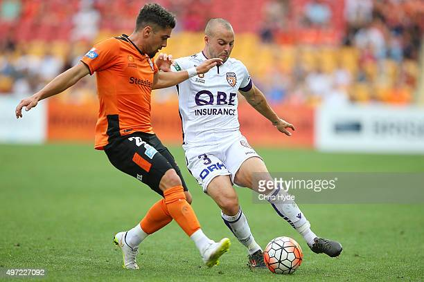 Dimitri Petratos of the Roar and Marc Warren of the Glory compete for the ball during the round six ALeague match between Brisbane Roar and Perth...