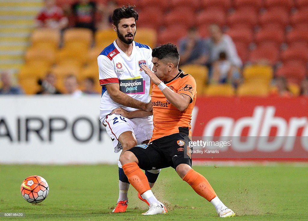 Dimitri Petratos of the Roar and Nicholas Cowburn of the Jets challenge for the ball during the round 19 A-League match between the Brisbane Roar and the Newcastle Jets at Suncorp Stadium on February 12, 2016 in Brisbane, Australia.