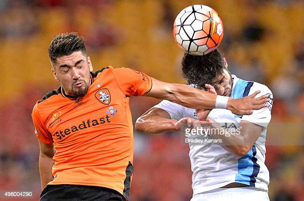 Dimitri Petratos of the Roar and Paulo Retre of Melbourne City challenge for the ball during the round seven ALeague match between the Brisbane Roar...