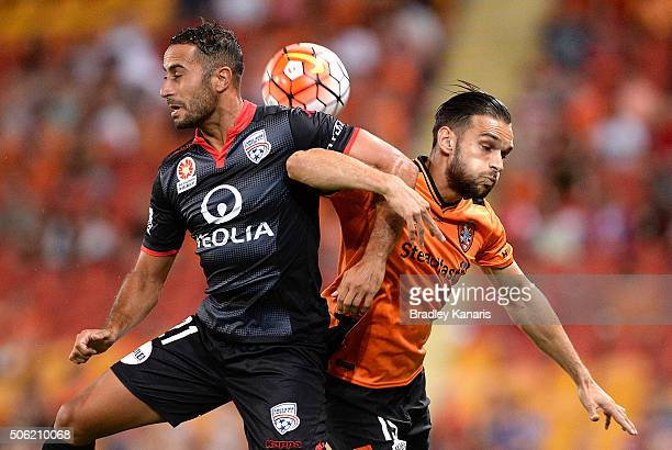 Dimitri Petratos of the Roar and Tarek Elrich of Adelaide compete for the ball during the round 16 ALeague match between the Brisbane Roar and...