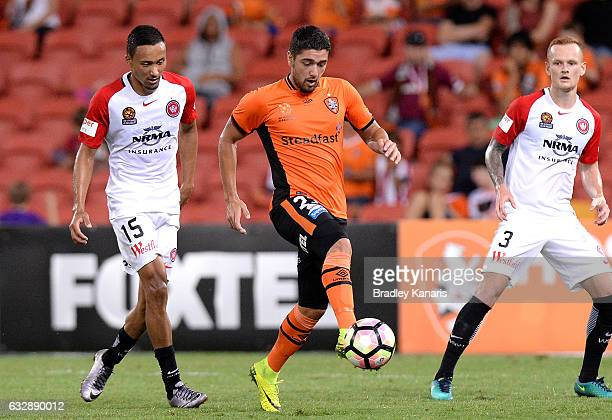 Dimitri Petratos of the Roar breaks away from the defence during the round 17 ALeague match between the Brisbane Roar and the Western Sydney...