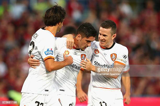 Dimitri Petratos of the Roar celebrates with team mates after scoring a penalty goal during the ALeague Semi Final match between the Western Sydney...