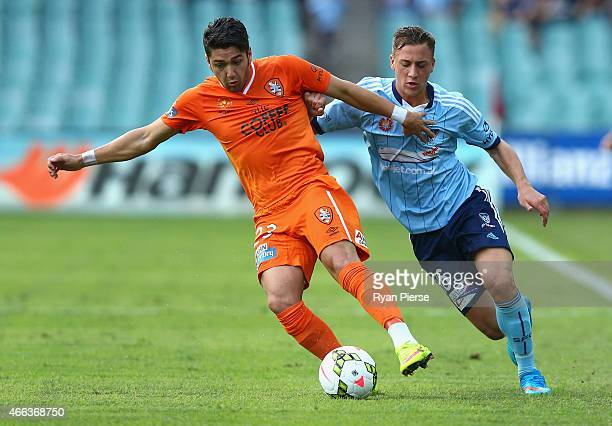 Dimitri Petratos of the Roar competes for the ball against Alex Gersbach of Sydney FC during the round 21 ALeague match between Sydney FC and...