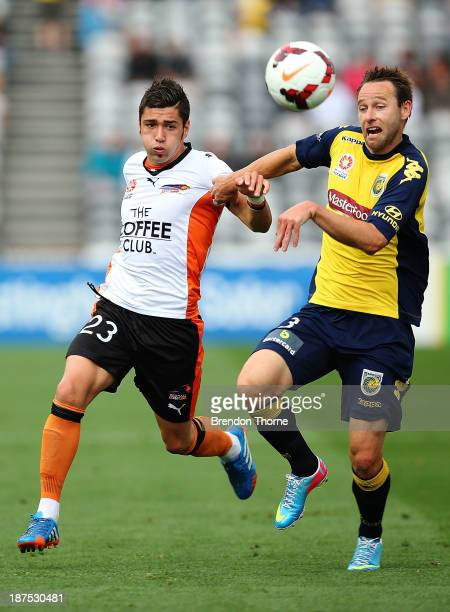 Dimitri Petratos of the Roar competes with Joshua Rose of the Mariners during the round five ALeague match between the Central Coast Mariners and...