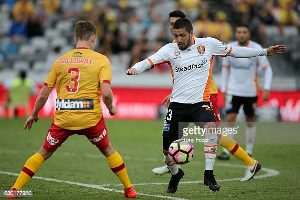 Dimitri Petratos of the Roar contests the ball with Scott Galloway of the Mariners during the round 11 ALeague match between the Central Coast...