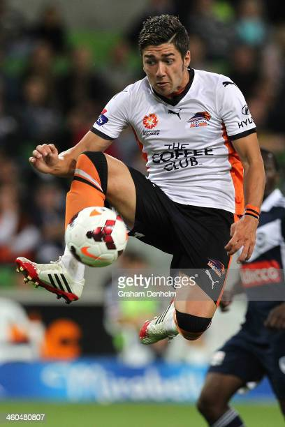 Dimitri Petratos of the Roar controls the ball in the air during the round 13 ALeague match between the Melbourne Victory and Brisbane Roar at AAMI...