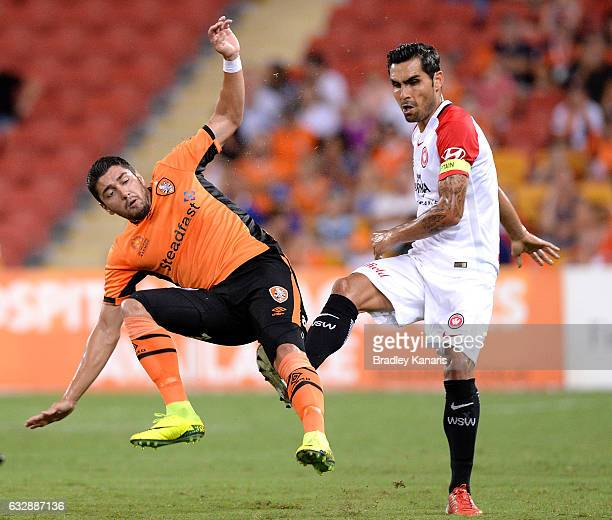 Dimitri Petratos of the Roar is fouled by Dimas Delgado of the Wanderers during the round 17 ALeague match between the Brisbane Roar and the Western...