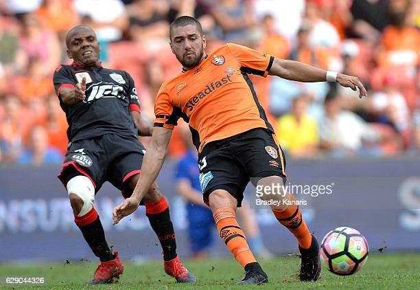 Dimitri Petratos of the Roar is fouled in this tackle by Henrique of Adelaide during the round 10 ALeague match between the Brisbane Roar and...