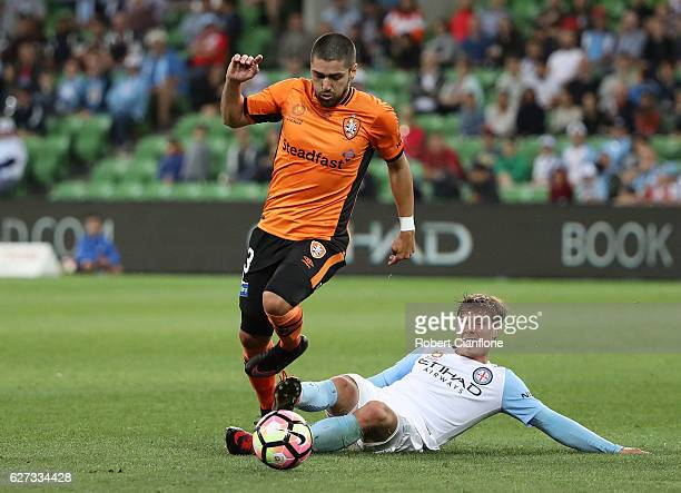 Dimitri Petratos of the Roaravoids a tackle from Nick Fitzgerald of Melbourne City during the round nine ALeague match between Melbourne City FC and...