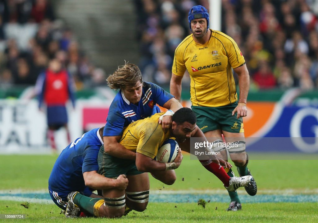 Dimitri Szarzewski and Nicolas Mas of France tackle Wycliff Paulu of Australia during the Autumn International match between France and Australia at Stade de France on November 10, 2012 in Paris, France.