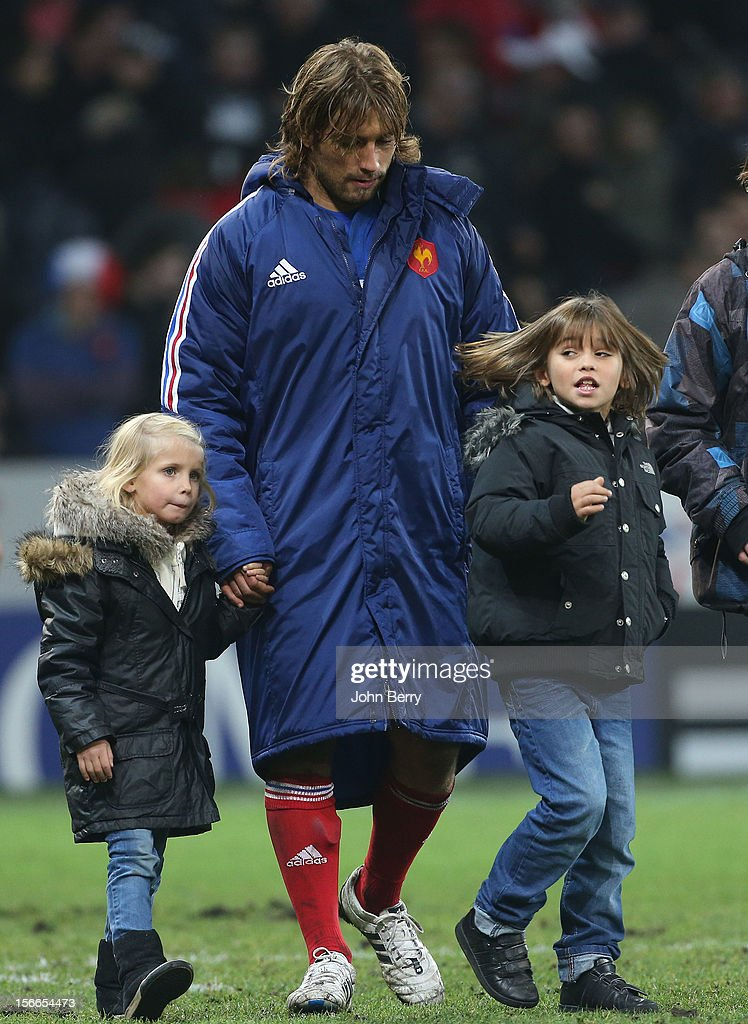 Dimitri Szarzweski of France and his kids on the field after the rugby autumn international between France and Argentina (39-22) at the Grand Stade Lille Metropole on November 17, 2012 in Lille, France.
