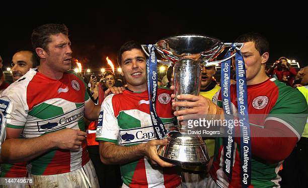 Dimitri Yachvili celebrates with team mates Jerome Thion and Wenceslas Lauret after their victory in the Amlin Challenge Cup Final between Biarritz...