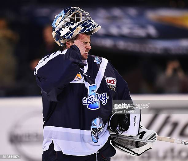Dimitrij Kotschnew of Hamburg wipes away tears during the Bundesliga ice hockey match between Hamburg Freezers and Adler Mannheim at Barclaycard...