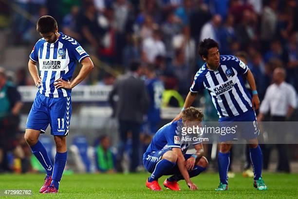 Dimitrij Nazarov Philipp Max and Hiroki Yamada of Karlsruhe react after the Second Bundesliga match between Karlsruher SC and SV Darmstadt 98 at...
